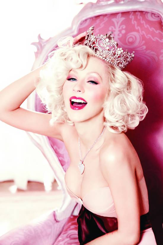 Christina Aguilera shows cleavage in photoshoot 2010 for Cosmopolitan - Hot Celebs Home