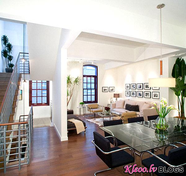 Black and white photos in a white living room