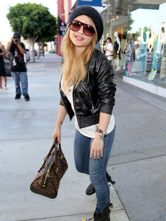 Tila Tequila shows off her LV and matches it with a leather jacket and jeans