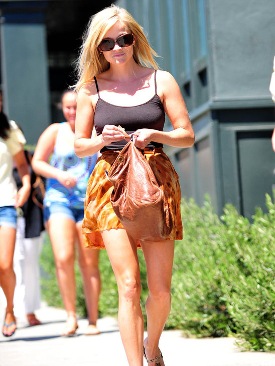 Reese Witherspoon is relaxed and pretty in a simple tank and soft mini skirt - we love that bag!