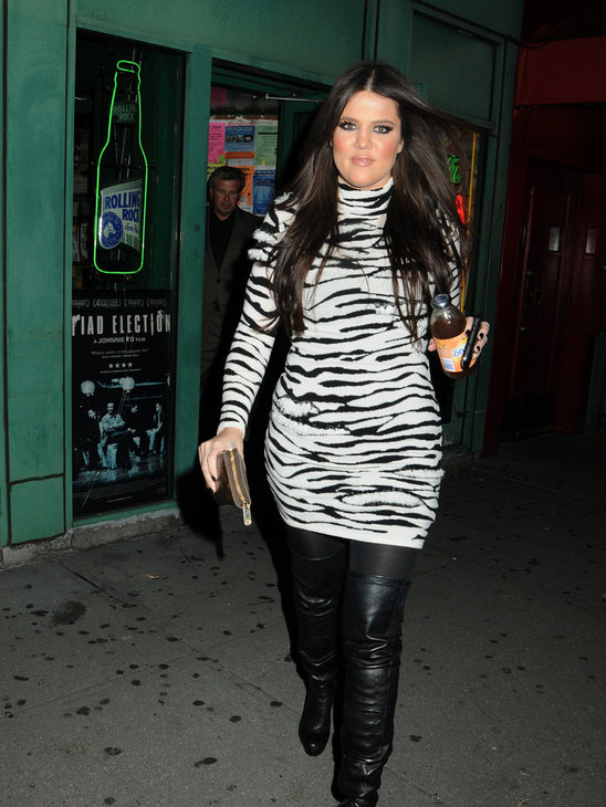 Khloe Kardashian knows animal print is hot and adds some extra spice with thigh-high boots