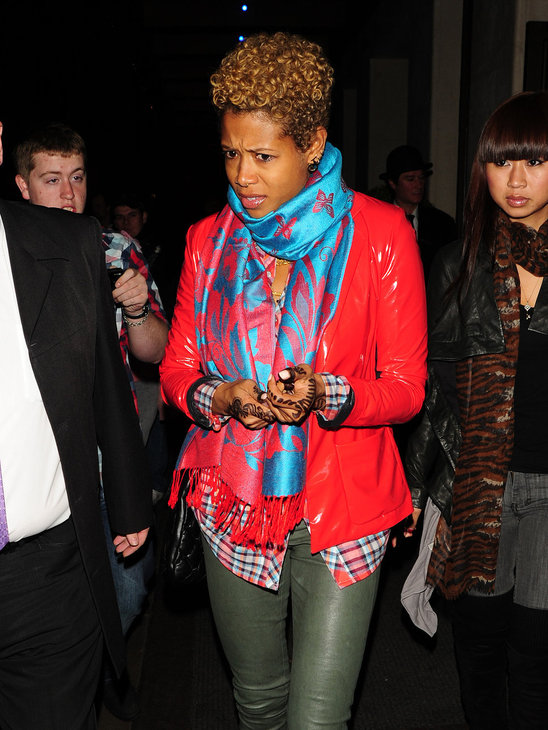 Kelis is bright and cheerful in sizzling red and bright blue