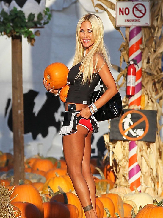 1. Trust Shauna Sands to make an innocent thing like choosing pumpkins for Halloween into something cheap and porno! It wasn't enough that she was wearing the shortest mini skirt in the world, but Shawna just couldn't resist flashing her bright red panties either! Yuck!